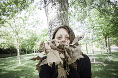 Girl with dry leaves Stock Photo