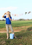 Girl drying banknotes Stock Image
