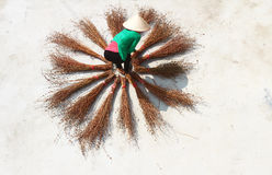 Girl drying brooms Stock Photography