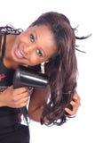 Girl drying hair Stock Images