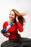 Girl Drying Her Hair Royalty Free Stock Images