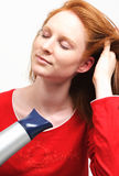 A Girl Drying Her Hair Stock Photography