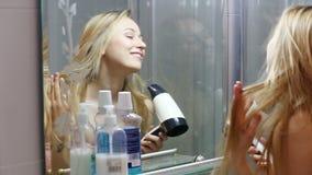 Girl drying her hair stock video