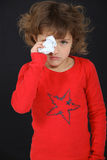 Girl drying her tears Royalty Free Stock Photography