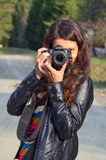 Girl with DSLR camera Royalty Free Stock Images