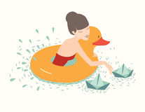 Girl with duck, lifebuoy floating Royalty Free Stock Photos