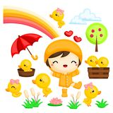 Girl and the duck playing in the rain. Little girl in the yellow rain coat and the ducks playing happily in the rain Royalty Free Stock Image