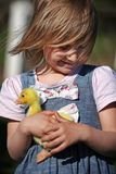 Girl with duckling. On a farm Royalty Free Stock Images
