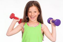 Girl with dumb bells Royalty Free Stock Photography