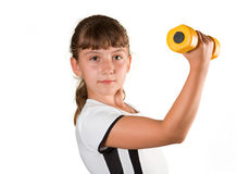 Girl with a dumbbell Royalty Free Stock Images