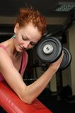 Girl with dumbbell in the gym Stock Photo