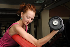 Girl with dumbbell in the gym Royalty Free Stock Images