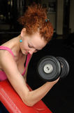 Girl with dumbbell in the gym Stock Photography