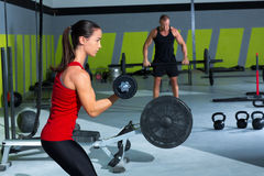 Girl dumbbell and man weight lifting bar workout Stock Photography