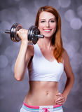 Girl with dumbbell Royalty Free Stock Image