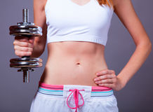Girl with dumbbell Stock Images