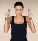 Girl with dumbbells Stock Photos