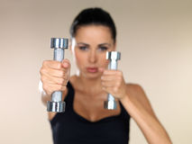 Girl with dumbbells Royalty Free Stock Photography