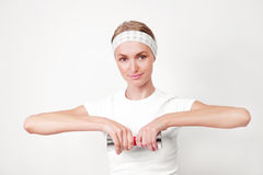 Girl with dumbbells Stock Images