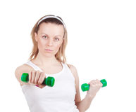 Girl with dumbbells Royalty Free Stock Image