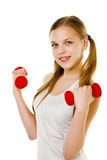 Girl with dumbbells Stock Photography