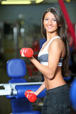 The girl with dumbbells. Look other photos of this series Royalty Free Stock Photography