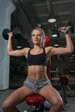 Girl and dumbbells Stock Photos