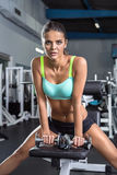 The girl with dumbbells. Royalty Free Stock Image