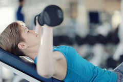 Girl with dumbbells in  gym Stock Photos