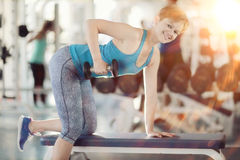 Girl with dumbbells in  gym Stock Photo