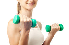 The girl with dumbbells in hands Royalty Free Stock Photo