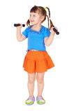 Girl with dumbbells in hands on white background Royalty Free Stock Photos