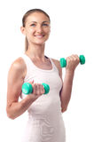 Girl with dumbbells in hands Royalty Free Stock Images