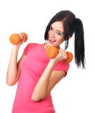 The girl with dumbbells isolated on a white Stock Photos