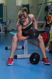 The girl with dumbbells Stock Photography