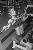 The girl with dumbbells Stock Image