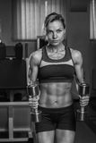 The girl with dumbbells Stock Images