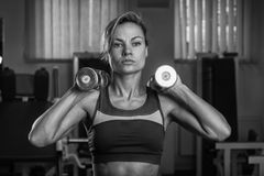The girl with dumbbells Royalty Free Stock Photo