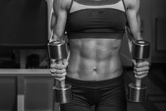 The girl with dumbbells Royalty Free Stock Image