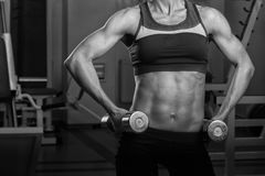 The girl with dumbbells Stock Photos