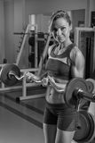 The girl with dumbbells Royalty Free Stock Images