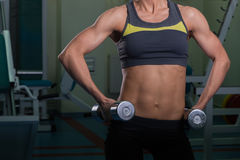 The girl with dumbbells Royalty Free Stock Photography