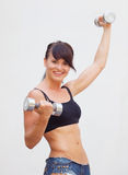 Girl with dumbell Royalty Free Stock Photos