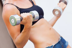 Girl with dumbell. In hands Stock Photos