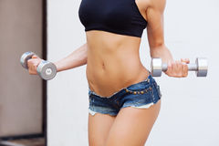 Girl with dumbell Royalty Free Stock Images