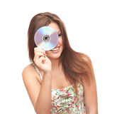 Girl and DVD. Smiling girl in white background holding DVD Royalty Free Stock Image