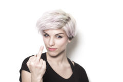Girl with dyed hair showing middle finger Royalty Free Stock Photos