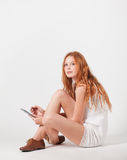 Girl with e-book Royalty Free Stock Photo