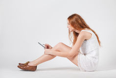 Girl with e-book Royalty Free Stock Photography