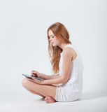 Girl with e-book Royalty Free Stock Images